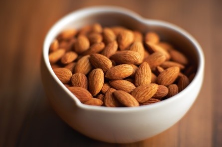 heart shaped bowl of almonds